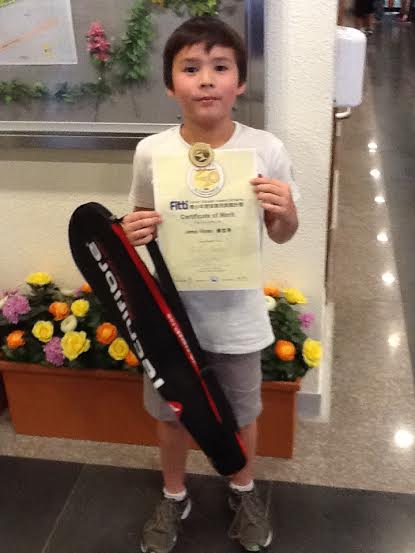 1_-_Young_James_with_his_HK_Squash_Gold_Award.jpg