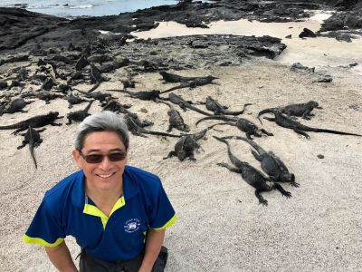 George Chan hanging out with the local beach bums  in Galapagos.