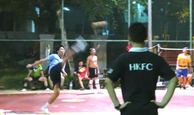 Dave Chan considering whether to change sports at a Kick Volley ball match in Thailand.