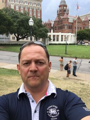 Dean Thompson on tour - standing on a grassy knoll in Dallas!! That was one shot that wasn't down!